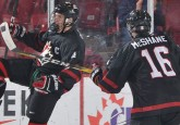 Team Alberta alumnus and World U17 Hockey Challenge All-Star Ty Smith (left) celebrates a goal with his Team Canada Black teammate. (Photo courtesy of Hockey Canada)