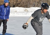 Duane Moleni (right) works on his skating with Hockey Alberta Foundation Board Vice Chair Dennis Zukiwsky (left).