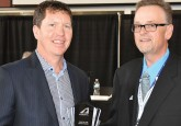 Doug Kinsella (left), accepts the Chairman of the Board award from Terry Engen during Hockey Alberta's Annual General Meeting