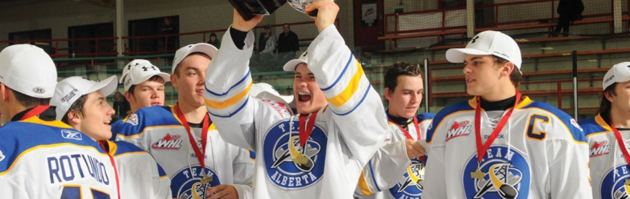 Team Alberta alumni Sam Steel (centre) and Kale Clague (right) celebrate Team Alberta's 2013 Western Canada U16 Challenge Cup win. (Photo credit: LA Media)