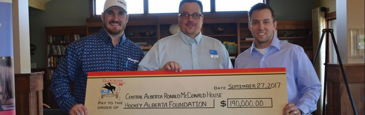 From left: Curtis Glencross, Hockey Alberta Foundation Executive Director Tim Leer, and Curtis Glencross and Friends Foundation Director Kelsey Angeltvedt