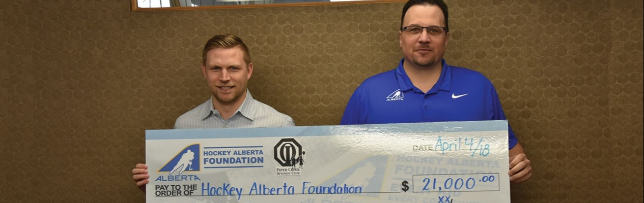 Piper Creek Optimist Club of Red Deer's Past President Kevin Walsh (left), with Hockey Alberta Foundation Executive Director Tim Leer.