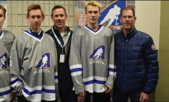 (From left) Mark and Ridly Greig, Jake and Geoff Sanderson, and Brayden and Brendan Morrison.