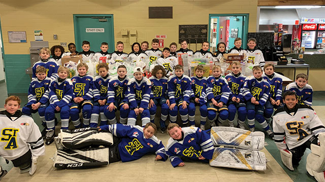 e440534f07c The St. Albert SA731 and SA732 challenged parents and fans to bring  donations for the local food bank to their game.